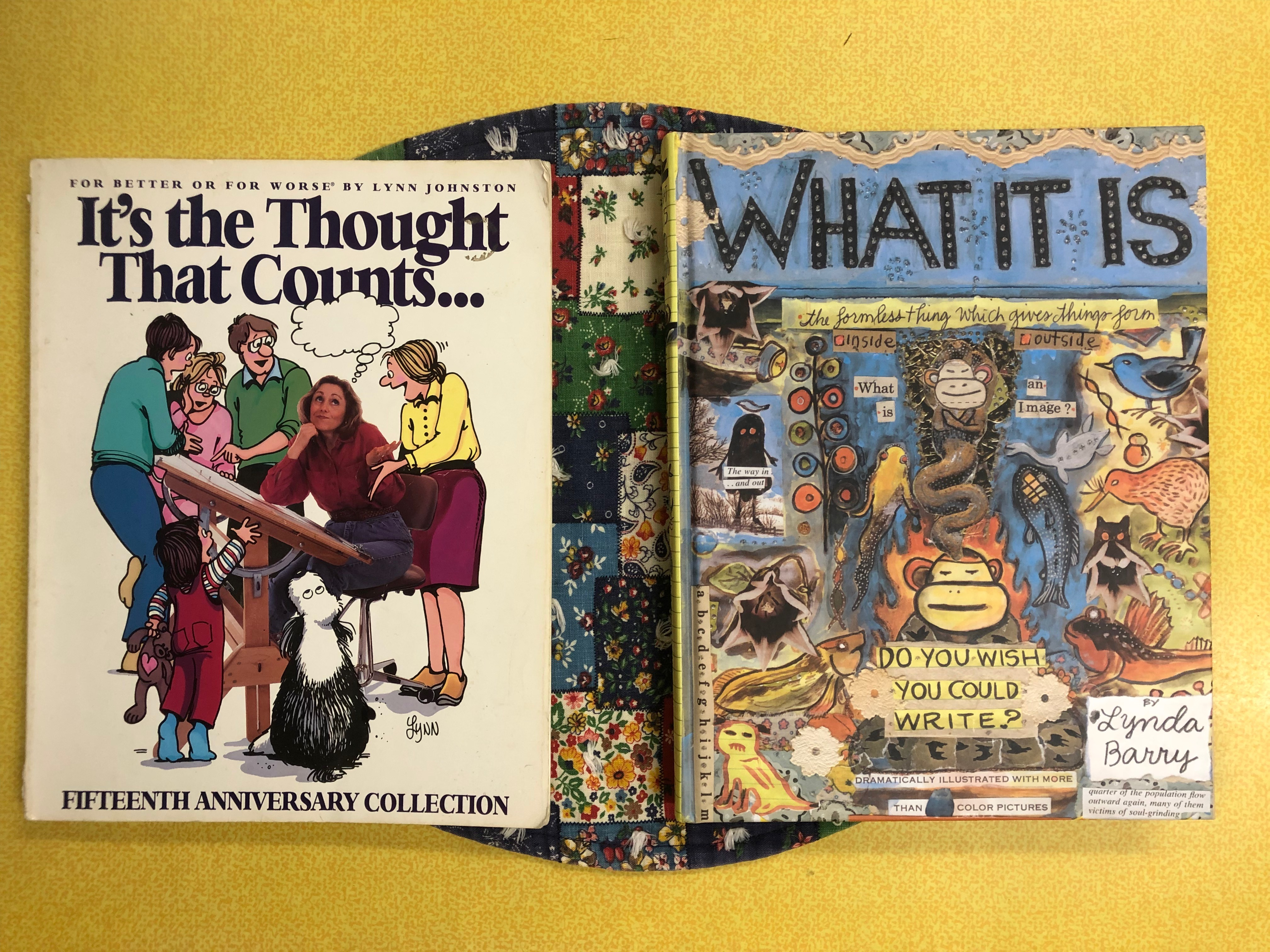 This photo is a birds-eye view of two books seated on top of a round, quilted place mat on a yellow, laminated kitchen table. The book on the left is Lynn Johnson's book It's the Thought That Counts, and the book on the right is Lynda Barry's what it is.