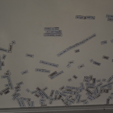 Magnetic poetry kit words on a whiteboard