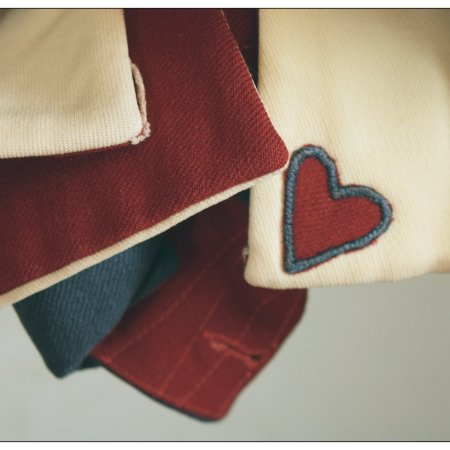 Heart detail on a colonial soldier's uniform.